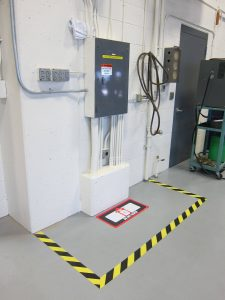 Electrical panel with floor sign and safety tape